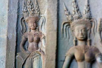 carved apsara dancers