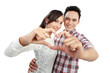 young couple in love showing heart with fingers
