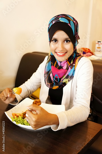 Pretty Muslim girl lunch at cafe