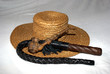 straw hat with a whip and a wooden smoking pipe