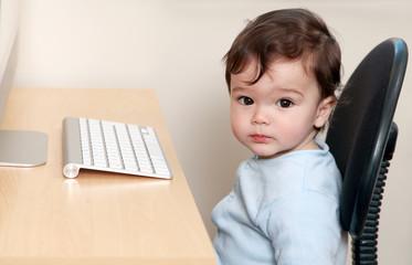 Baby sat at desk