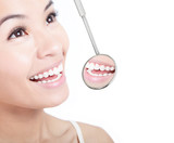 Fototapety Healthy woman teeth and a dentist mouth mirror