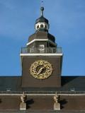 Turm mit Uhr an einem alten Gymnasium in Offenbach am Main poster