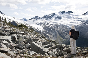 A tourist admiring glaciers in Glacier National Park