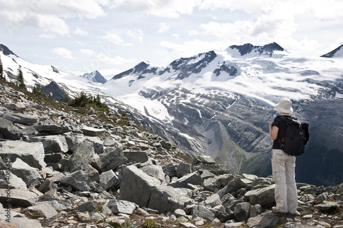 A tourist admiring glaciers in Glacier National Park