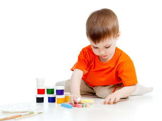 cute child with paints and chalks