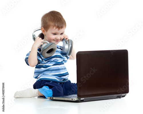 Funny child playing with laptop