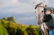 Leinwandbild Motiv Horse riding - portrait of lovely equestrian with horse
