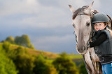 Horse riding - portrait of lovely equestrian with horse