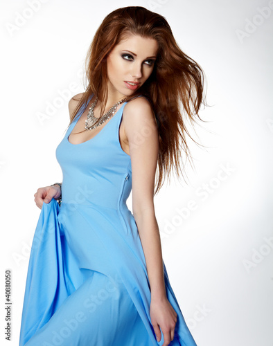 Woman in blue dress dancing