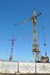 Two construction cranes.