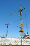 Two construction cranes.