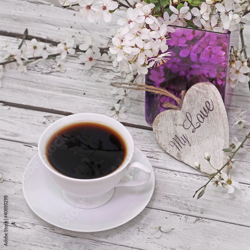 spring blossom, coffee and heart  on wood background