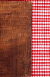 Rustic wooden background with red and white tablecloth