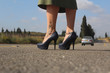 Woman with leg tattoo standing on the road