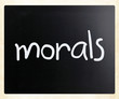 """Morals"" handwritten with white chalk on a blackboard"