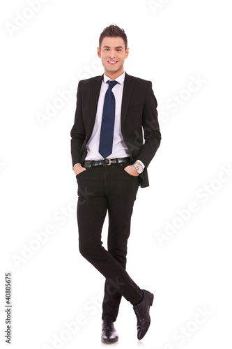 business man standing with hands in pocket