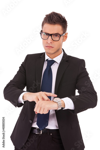 business man showing you that you are late