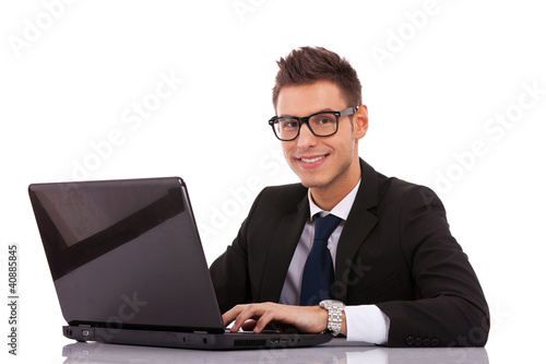 business man wearing glasses  using a laptop