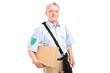 A mature postman delivering a box