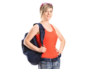 A portrait of a female student with school bag