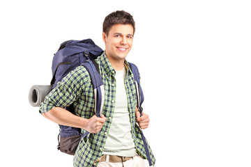 A portrait of a hiker with backpack posing