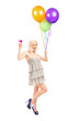 Attractive woman holding balloons and cocktail