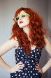 Fashion portrait of red haired girl.