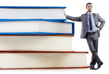 Businessman with books on white