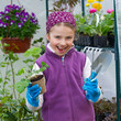 Gardening - lovely girl with seedling in greenhouse