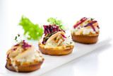 crostini appetizer with pear, radicchio and green salad