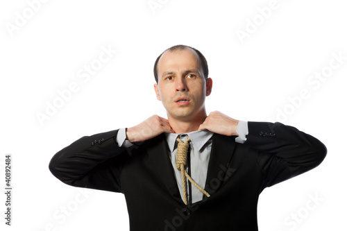 Businessman with gallow tie suffocating and trying to free himse