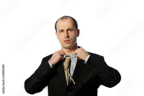 Businessman with gallow tie suffocating and trying to have a bre