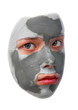 Sad teenager with grey cosmetic mask