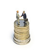 Miniature handshake euro coin tower