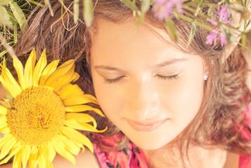 Girl sleeping  among flowers