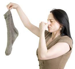 woman with dirty sock holding her nose