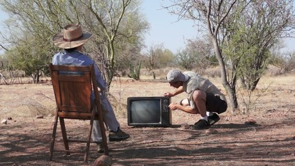 Woman and Man out in the Boonies with Old TV
