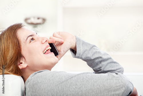 woman have joyful talk over telephone