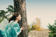 girl in medieval dress. strong wind