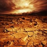 Fototapety Stormy sky over desert.