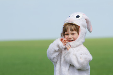 happy child dressed as rabbit on natural background