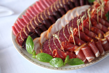 Assortment of cold meat and salami on dish