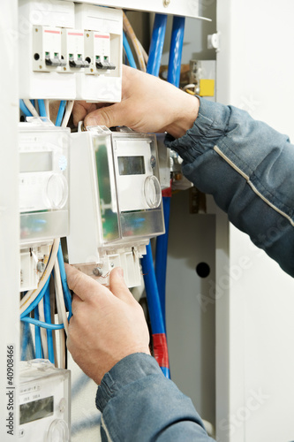 Close-up Electrician hands installing energy meter