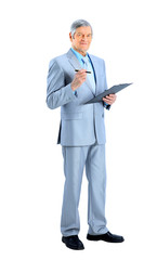 Nice businessman at the age, writes the work plan