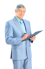 Nice businessman at the age, writes the work plan.