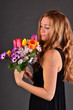 Springtime: young woman with a colorful bouquet of flowers