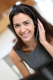 Portrait of smiling receptionist with headphones
