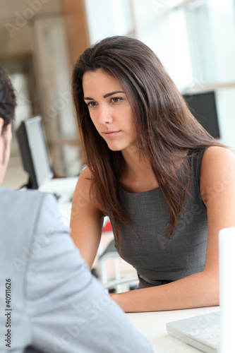 Young woman being interviewed for a job position