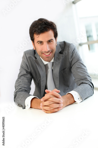 Smiling businessman looking at client